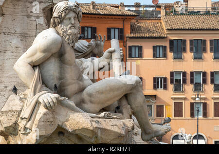 Fontana dei Quattro Fiumi  (Fountain of the Four Rivers),  detail showing the river-god Ganges, designed by Gian Lorenzo Bernini in 1651. in the Piazz - Stock Photo