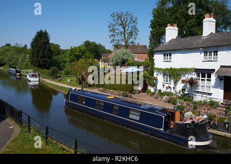 A narrowboat on the Bridgewater Canal at Lymm, Cheshire, UK. - Stock Photo