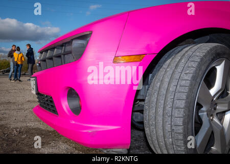 Warsaw Poland - October 21, 2018: Pink sports car at amateur drifting event in Warsaw, Poland - Stock Photo