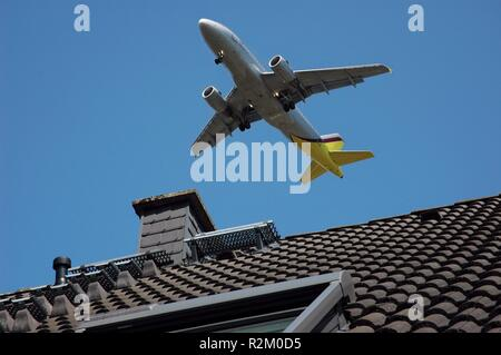 airplane over the city - Stock Photo