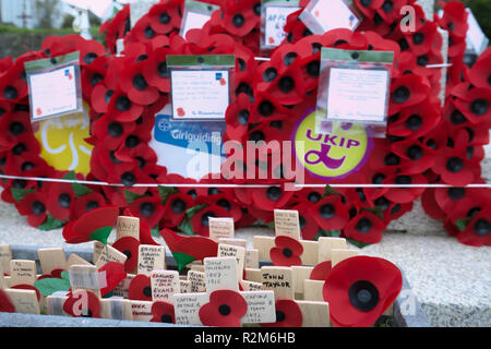 Wreaths laid at the memorial stone at St Mary's Parish Church in Appledore, Devon - Stock Photo