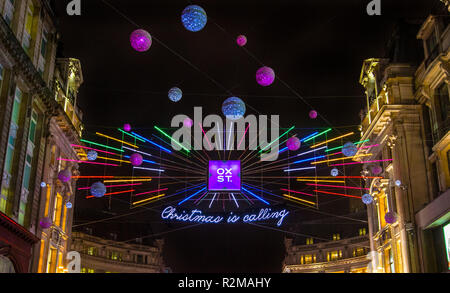 London, UK - November 19th 2018: A view of the festive Christmas lights on Oxford Street in London. - Stock Photo
