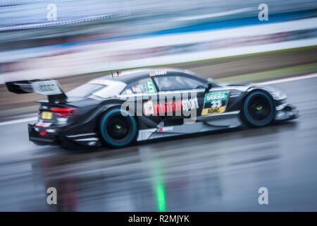 DTM racing car driving in the rain, racetrack - Stock Photo