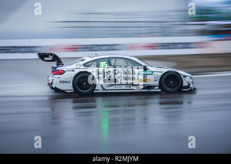 DTM racing car on wet race track, BMW M4 DTM - Stock Photo