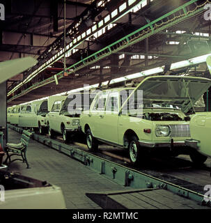 Assembly line with Wartburg limousines in the VEB automobile plant Eisenach - Stock Photo