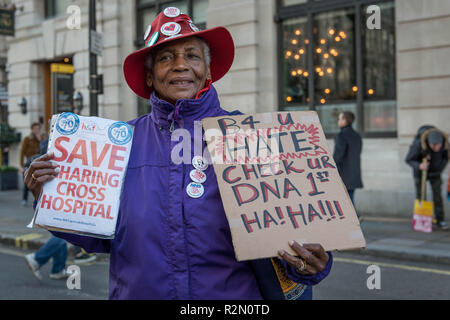 A protester seen holding placards during the protest. Huge crowds marched from the BBC in Portland Place to Whitehall with flags and placards during the National Unity Demonstration to oppose the rise of fascist and racist activity in Europe, The demonstration was called by Unite against Fascism, Love Music Hate Racism and Stand up to racism movements. The speeches in Whitehall were disrupted by the presence of a small number of far right activists and Trump supporters. - Stock Photo