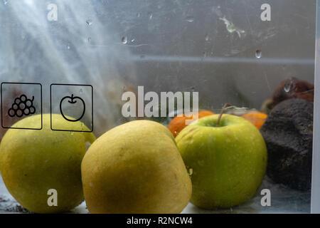 rotten fruit in refrigerator fruit bin - Stock Photo