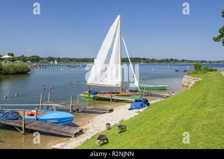 Sailboat on the shores of Lake Chiemsee in Prien, Chiemgau, Chiemgau, Upper Bavaria, Bavaria, Southern Germany, Germany, Europe - Stock Photo
