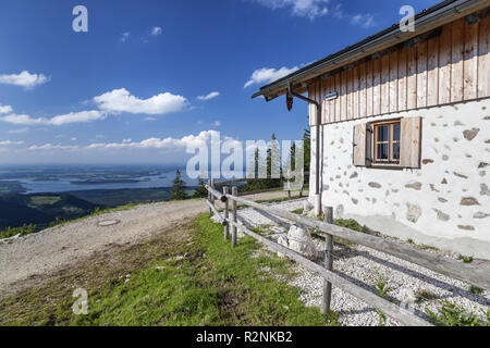Cheese from the Piesenhauser alp in the Chiemgau Alps with views of Lake Chiemsee, Marquartstein, Chiemgau, Upper Bavaria, Southern Germany, Germany, Europe - Stock Photo