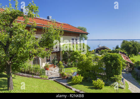 house at Chiemsee on the Fraueninsel, Frauenchiemsee, Chiemsee, Chiemgau, Upper Bavaria, Bavaria, Southern Germany, Germany, Europe - Stock Photo