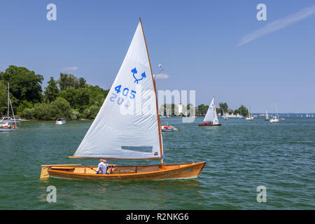Sailor Chiemseeplätte on Lake Chiemsee behind it Fraueninsel, Frauenchiemsee, Chiemgau, Upper Bavaria, Bavaria, Southern Germany, Germany, Europe - Stock Photo