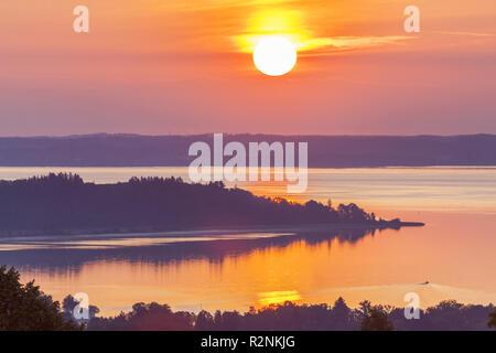 Sunrise at the Chiemsee near Bernau, Chiemgau, Upper Bavaria, Bavaria, southern Germany, Germany, Europe - Stock Photo