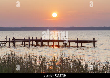 Jetty at sunrise at Lake Chiemsee in Gstadt, Chiemgau, Upper Bavaria, Bavaria, southern Germany, Germany, Europe - Stock Photo