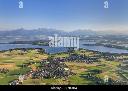 Flight over the Chiemsee with views of Breitbrunn behind the Herreninsel and Chiemgau Alps, Chiemgau, Upper Bavaria, Bavaria, southern Germany, Germany, Europe - Stock Photo
