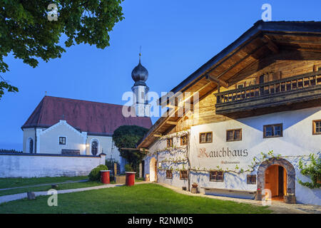 Restaurant Rauchhaus with church St. Ägidius in Seeon, community Seeon-Seebruck, Chiemgau, Upper Bavaria, Bavaria, southern Germany, Germany, Europe - Stock Photo