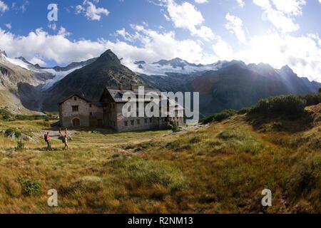 Hiker at the Berliner hut, Zillertal Alps, Tyrol, Austria. - Stock Photo