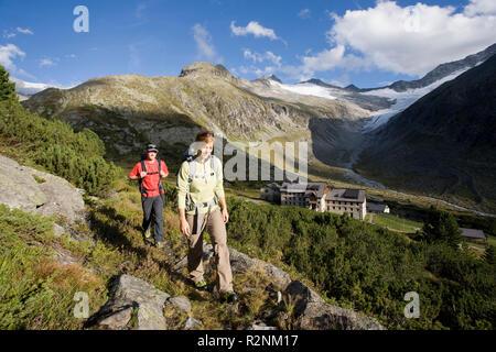 Hiker over the Berliner hut, Zillertal Alps, Tyrol, Austria. - Stock Photo