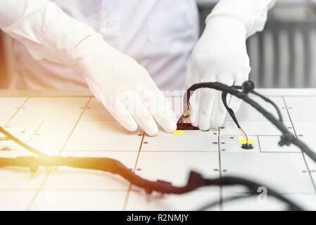 Checking the wiring systems on control desk, checkpoint, automotive industry, manufacturing of high-quality products - Stock Photo