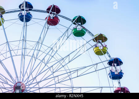 Ferris wheel in amusement park in blue sky background - Stock Photo