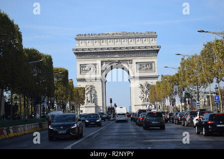 Paris, France - 2018: Traffic down the Champs Elysees Avenue and the Arc de Triomphe. - Stock Photo