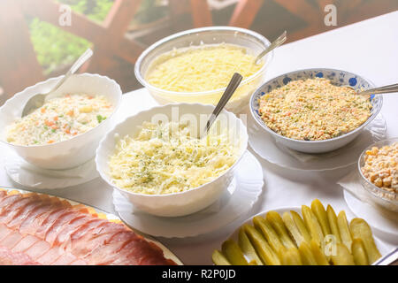 Different types of delicious salads. Wedding day food table. - Stock Photo