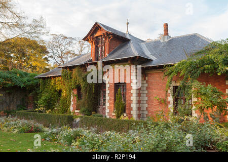 The House of the Bagatelle gardener and its vegetable garden. Paris, France - Stock Photo