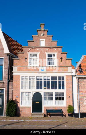 Historic house with stepped gable in old town of Enkhuizen, Noord-Holland, Netherlands - Stock Photo