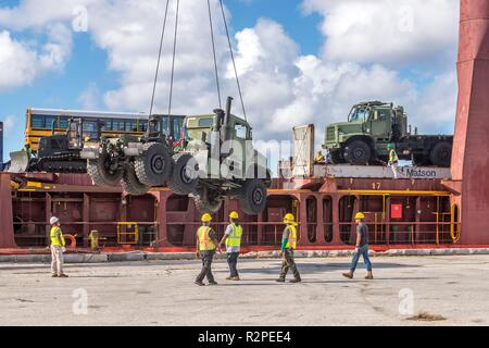 TINIAN, Commonwealth of the Northern Marianas Islands (Nov. 4, 2018) A Medium Tactical Vehicle Replacement (MTVR) assigned to Naval Mobile Construction Battalion (NMCB) 1 is offloaded at the Tinian wharf for use by the Seabees during recovery efforts following Super Typhoon Yutu. NMCB 1 received more than 40 pieces of heavy equipment that will increase their capacity and ability to operate. Service members from Joint Region Marianas and Indo-Pacific Command are providing Department of Defense support to the Commonwealth of the Northern Mariana Islands' civil and local officials as part of the  - Stock Photo