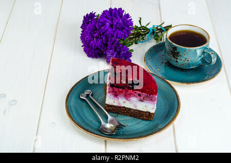 Piece of jelly mousse cake with fruit, cup of tea. Studio Photo - Stock Photo