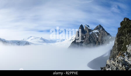 View of Orne Harbour glacier in mist from Spigot Peak, Antarctic Peninsula, Antarctica - Stock Photo