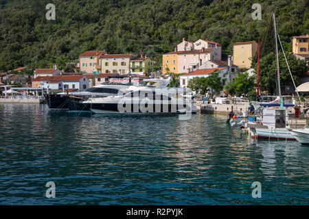 Anchoring yachts in the port of Valun, Island of Cres, Kvarner Bay, Croatia - Stock Photo