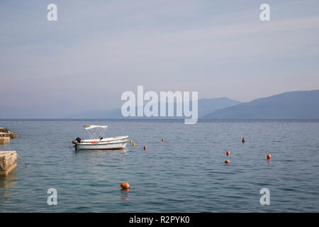 Small boats in the harbour of Valun, Island of Cres, Kvarner Bay, Croatia - Stock Photo