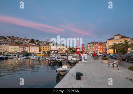 Evening mood, harbour promenade of Mali Losinj, Losinj Island, Kvarner Bay, Croatia - Stock Photo