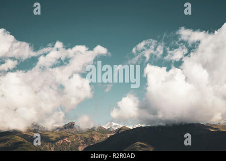Clouds above Großvenediger Peak, view from Innichen in South Tyrol, Italy - Stock Photo