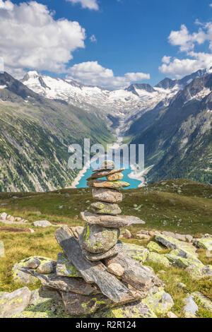 Cairns near Olperer hut, in the valley the Schlegeis Strausee, Zillertal Alps, Tyrol, Schwaz district, Austria - Stock Photo
