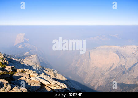 View towards Half Dome and the valley beyond on a day with low visibility due to the smoke coming from the Ferguson Fire, Yosemite National Park - Stock Photo