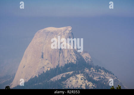 View towards Half Dome on a day with low visibility due to the smoke coming from the Ferguson Fire, Yosemite National Park, California - Stock Photo