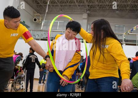 KOJE-DO, Republic of Korea (Nov. 03, 2018) Sailors participate in a community relations event with residents of the Aikwangwon Home and School for the Mentally and Physically Disabled in Koje-do. The U.S. Navy and Aikwangwon community outreach program spans more than 60 years and began when U.S. Navy doctors and nurses assigned to the U.S. Navy base in Chinhae volunteered at the home during the Korean War. - Stock Photo