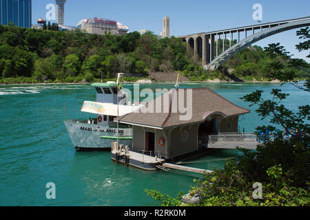 NIAGARA FALLS, USA - JUNE 1, 2010:  Tourists boarding the Maid of the Mist in Niagara Falls, USA. - Stock Photo