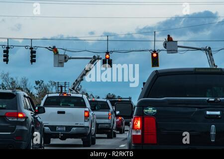 Panama City, FL., Nov. 2, 2018--Utility workers restore power to traffic lights in the Florida Panhandle after Hurricane Michael struck on October 10, as a Category 4 hurricane, packing 155 mph winds. FEMA/K.C. Wilsey - Stock Photo