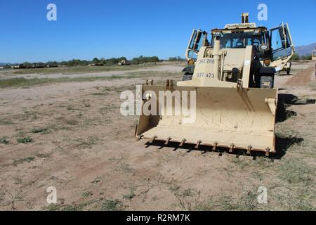A High Mobility Engineer Excavator assigned to 36th Engineer Brigade, from Fort Hood, Texas, arrives at Davis-Monthan Air Force Base, Tucson Ariz. Nov. 5, 2018. U.S. Northern Command is providing military support to the Department of Homeland Security and U.S. Customs and Border Protection to secure the southern border of the United States. - Stock Photo