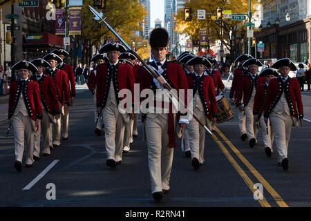 Soldiers assigned to the U.S. Army Fife and Drum Corps, 4th Battalion, 3d U.S. Infantry Regiment (The Old Guard) march and perform in the 4th Annual Philadelphia Veterans Day Parade in Philadelphia, Pennsylvania, November 4, 2018. - Stock Photo