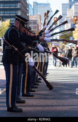 Soldiers assigned to the U.S. Army Drill Team, 4th Battalion, 3d U.S. Infantry Regiment (The Old Guard) perform after the conclusion of the 4th Annual Philadelphia Veterans Day Parade in Philadelphia, Pennsylvania, November 4, 2018. - Stock Photo