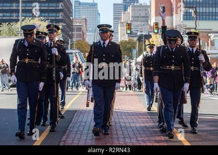 Soldiers assigned to the U.S. Army Drill Team, 4th Battalion, 3d U.S. Infantry Regiment (The Old Guard) complete the front to back rifle toss during a performance in Philadelphia, Pennsylvania, November 4, 2018. The performance took place after the conclusion of the 4th Annual Philadelphia Veterans Day Parade. - Stock Photo