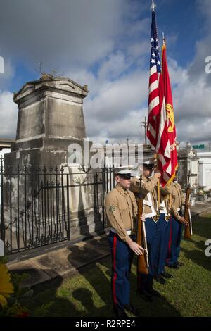 Marines with Marine Forces Reserve present the colors at a wreath laying ceremony for Marine Corps Maj. Daniel Carmick at St. Louis Cemetery No. 2 in New Orleans, Nov. 6, 2018. This ceremony is held annually to celebrate and honor the legacy and actions of Maj. Carmick during the Battle of New Orleans during the War of 1812. Maj. Carmick's leadership on the battlefield was an essential contribution that resulted in the defeat of British troops and prevented the seizure and conquest of the Louisiana territory. - Stock Photo