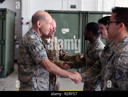 U.S Air. Force Gen. Mike Holmes, Air Combat Command commander, left, commends Airmen while at Tyndall Air Force Base, Florida, Nov. 7, 2018. His visit to Tyndall helped the major command get a firsthand update at the progress Tyndall is making in its post- Hurricane Michael recovery efforts. - Stock Photo