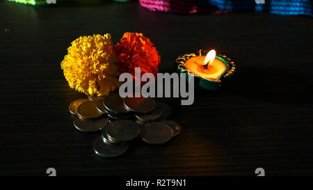 Illuminated diya arranged for celebrating diwali and dhanteras in India - Stock Photo