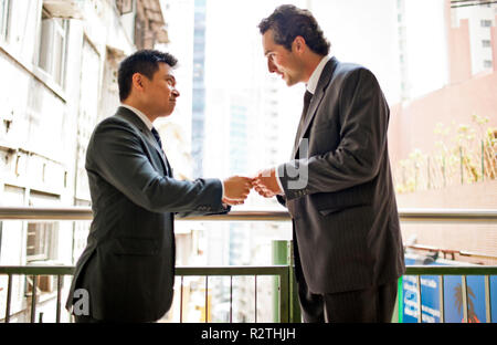 Two businessmen exchanging contact information. - Stock Photo