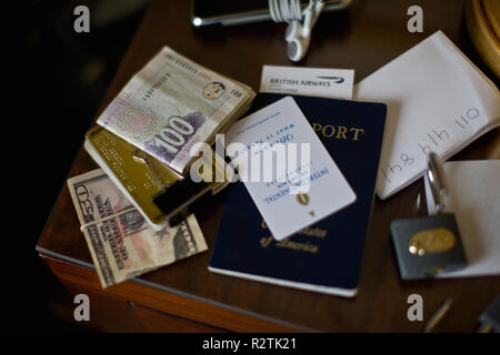 Credit card, paper money and passport on a table top. - Stock Photo