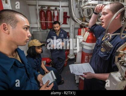 PACIFIC OCEAN (Nov. 9, 2018) Sailors conduct security systems training aboard the Ticonderoga-class guided-missile cruiser USS Mobile Bay (CG 53). Mobile Bay is underway conducting routine operations as part of Carrier Strike Group (CSG) 3 in the U.S. Pacific Fleet area of operations. - Stock Photo
